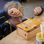 St Edward's student varnishing a treasure box